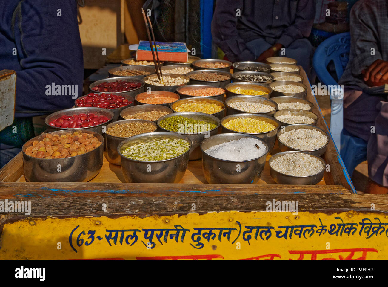 Food market in India selling dried pulses and lentils - Stock Image
