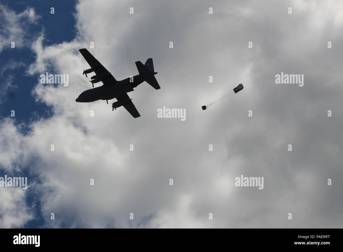 A C-130 Hercules aircraft completes a Container Delivery