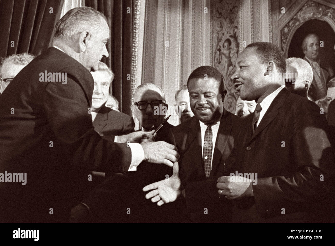 President Lyndon B. Johnson moves to shake hands with Dr. Martin Luther King after the signing of the Voting Rights Act on August 6, 1965 in the President's Room of the U.S. Capitol in Washington, D.C. Stock Photo