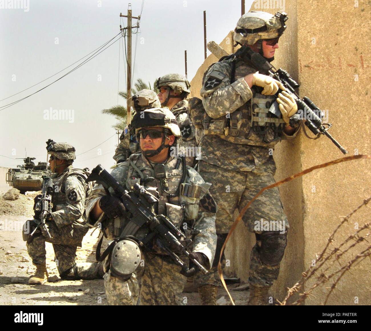 U.S. Army Soldiers from Bravo Company, 1st Battalion, 23rd Infantry Regiment conduct an area reconnaissance mission in Baghdad, Iraq, Aug. 11, 2006. Stock Photo
