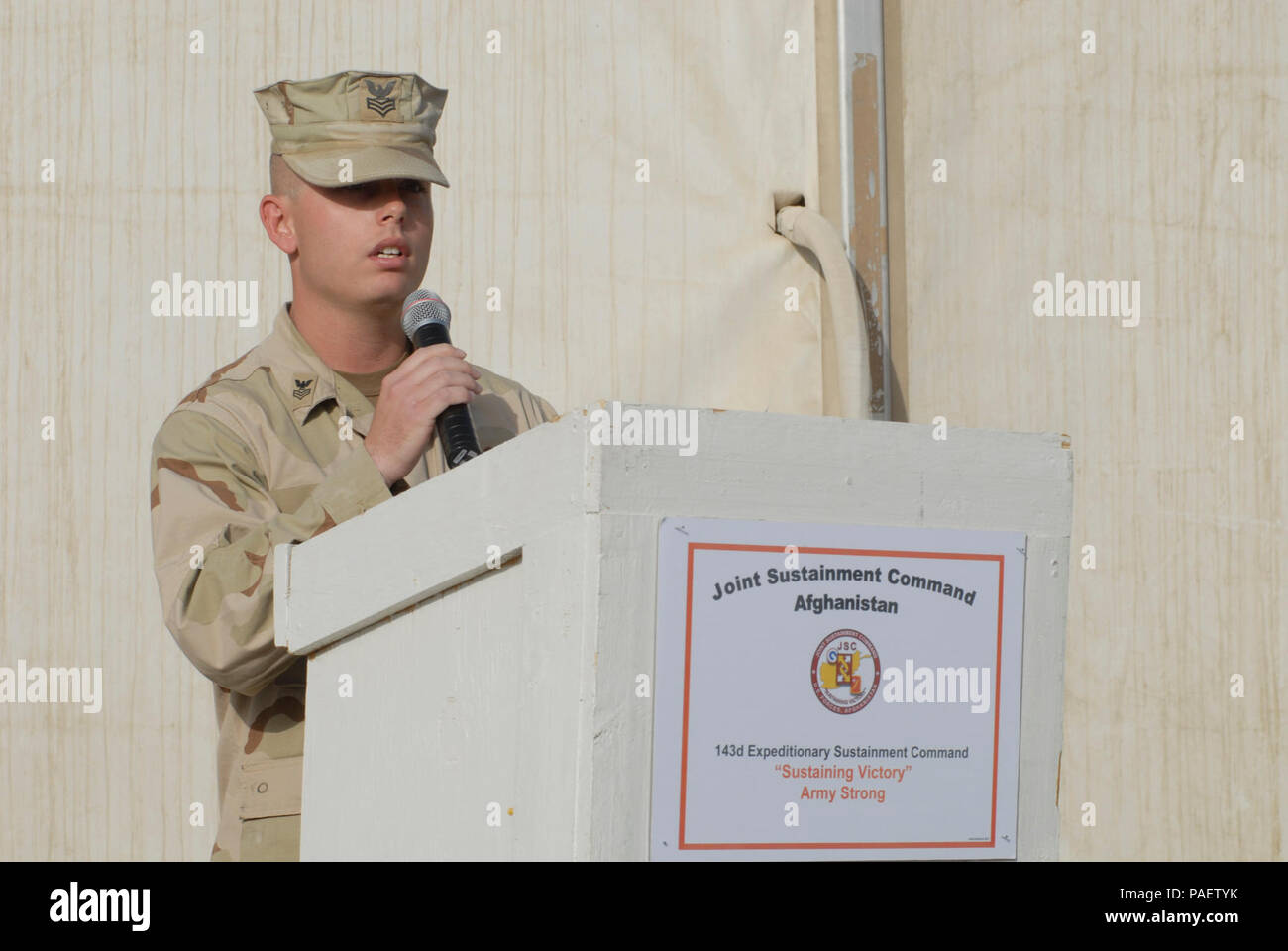 Chief Petty Officer Alan Grow of Bogalusa La., assigned to the 30th Naval Construction Regiment, delivers a message to service members during a memorial ceremony held at Kandahar Airfield. Sailors assigned to 30NCR and soldiers assigned to the 143D Expeditionary Sustainment Command, take time to honor those who lost their lives on Sept 11, 2001, and to pay tribute to the servicemen and women that have paid the ultimate sacrifice in support of Operations Iraqi Freedom and Enduring Freedom.  30NCR, homeported in Port Hueneme, Calif., and the 143d ESC, based in Orlando, Fla., are deployed to Afgh - Stock Image