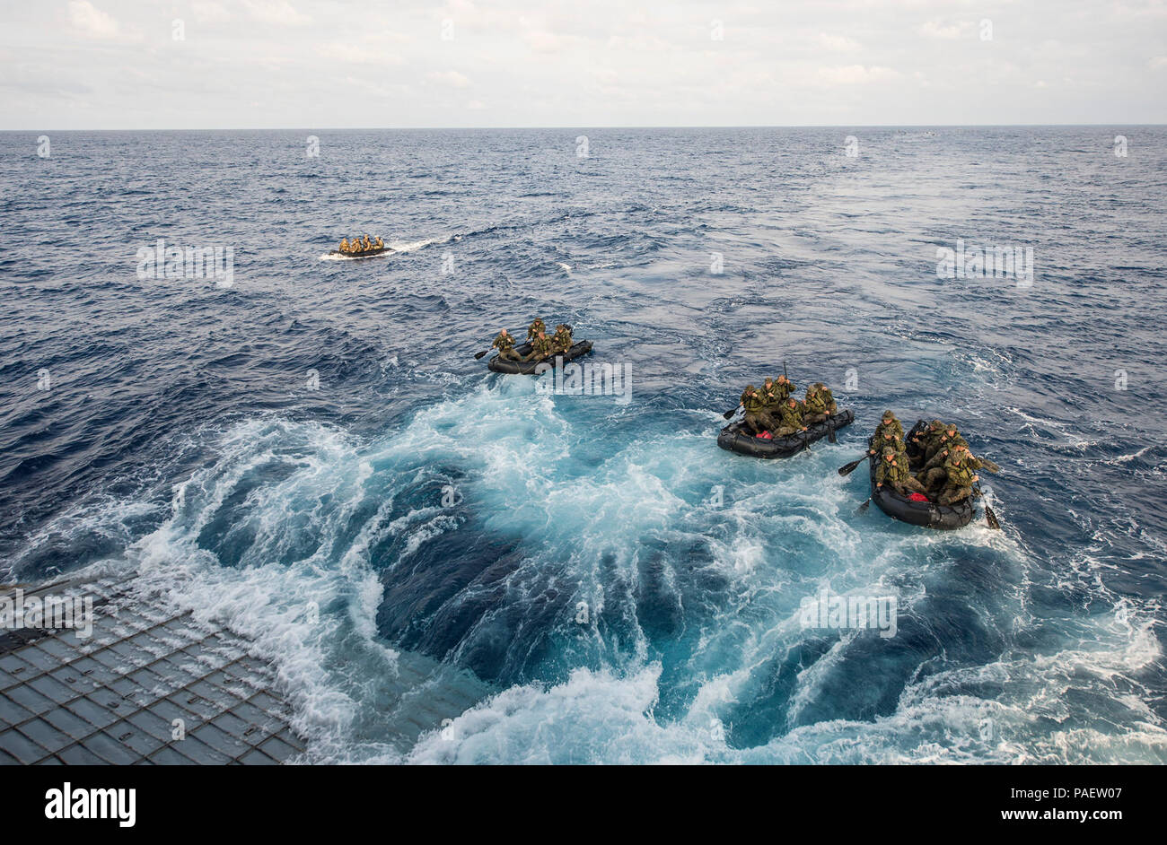 Marines assigned to Company F, Battalion Landing Team, 2nd Battalion, 5th Marines, 31st Marine Expeditionary Unit (31st MEU), conduct launch and recovery operations with combat rubber raiding craft from the well deck of the amphibious transport dock ship USS Denver (LPD 9). Denver is assigned to the Bonhomme Richard Amphibious Ready Group and is conducting operations in the U.S. 7th Fleet area of responsibility. Stock Photo