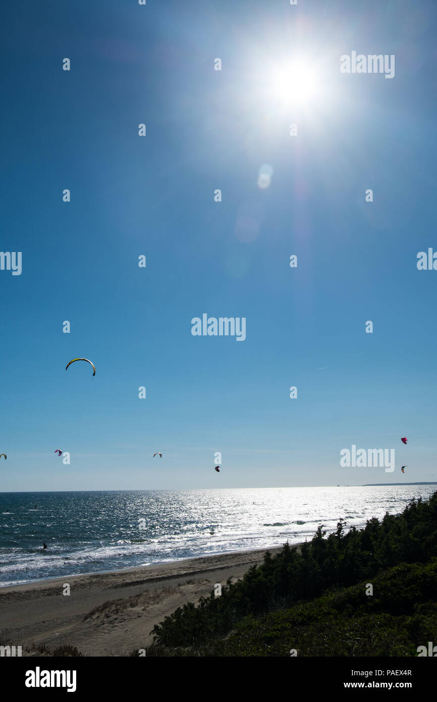 Kitesurfing and the shinny sun. - Stock Image