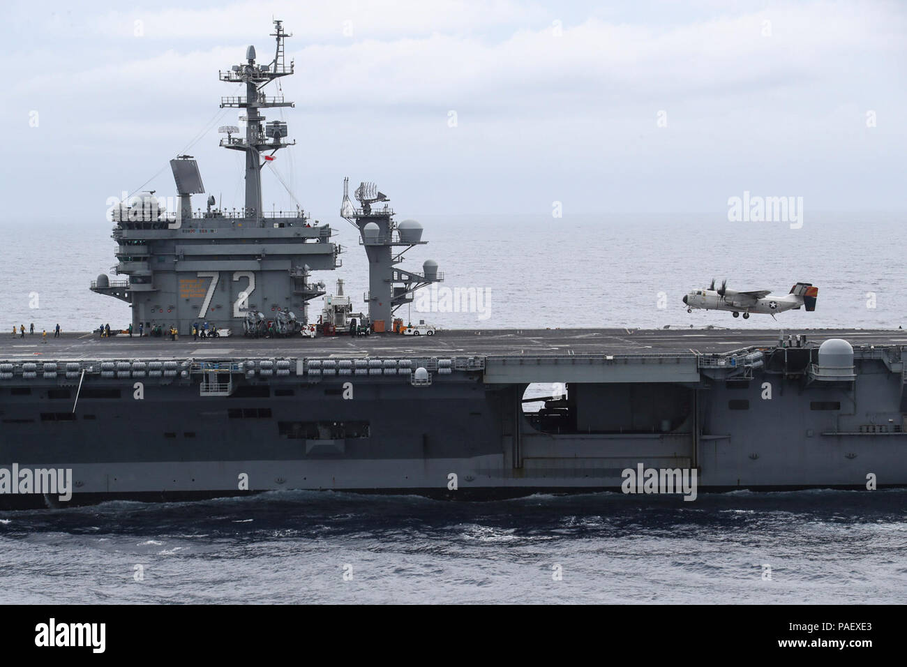 OCEAN (May 7, 2018) A C-2A Greyhound assigned to the Rawhides of Fleet Logistics Support Squadron (VRC) 40 prepares to land on the flight deck of the Nimitz-class aircraft carrier USS Abraham Lincoln (CVN 72). - Stock Image