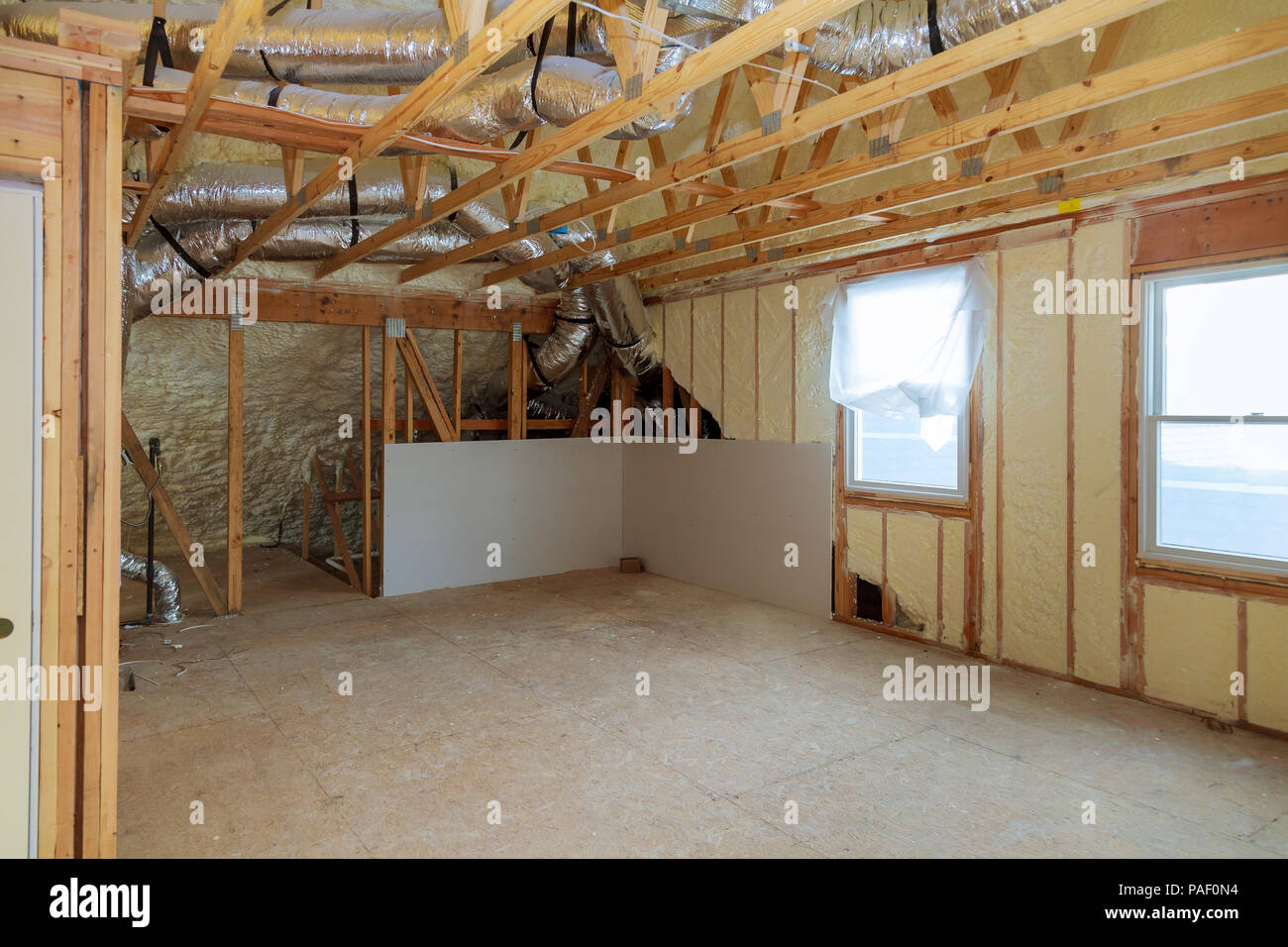 Work site of installing thermal foam insulation under the