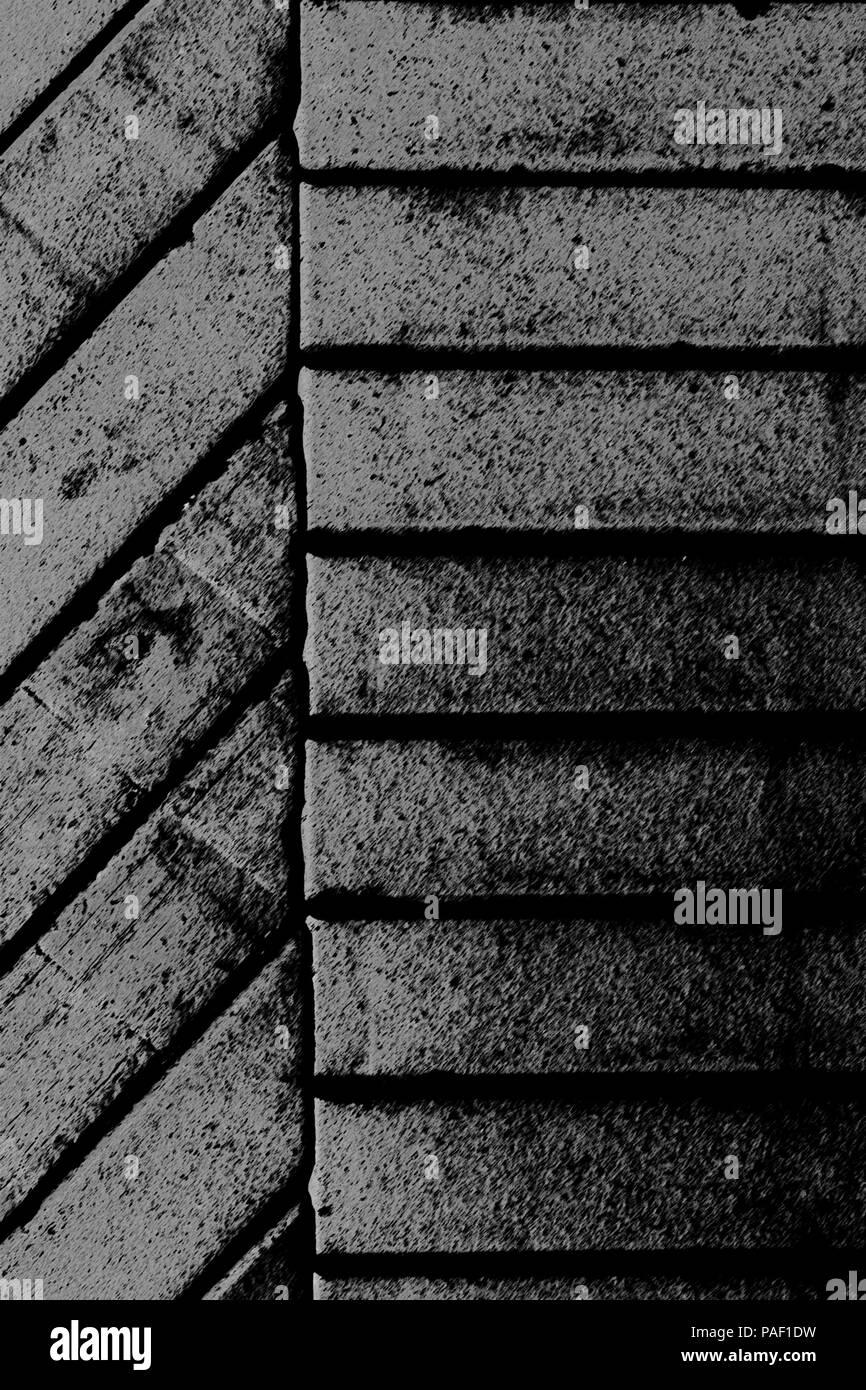 Grey narrow horizontal and diagonal stylised bricks background vertical composition - Stock Image