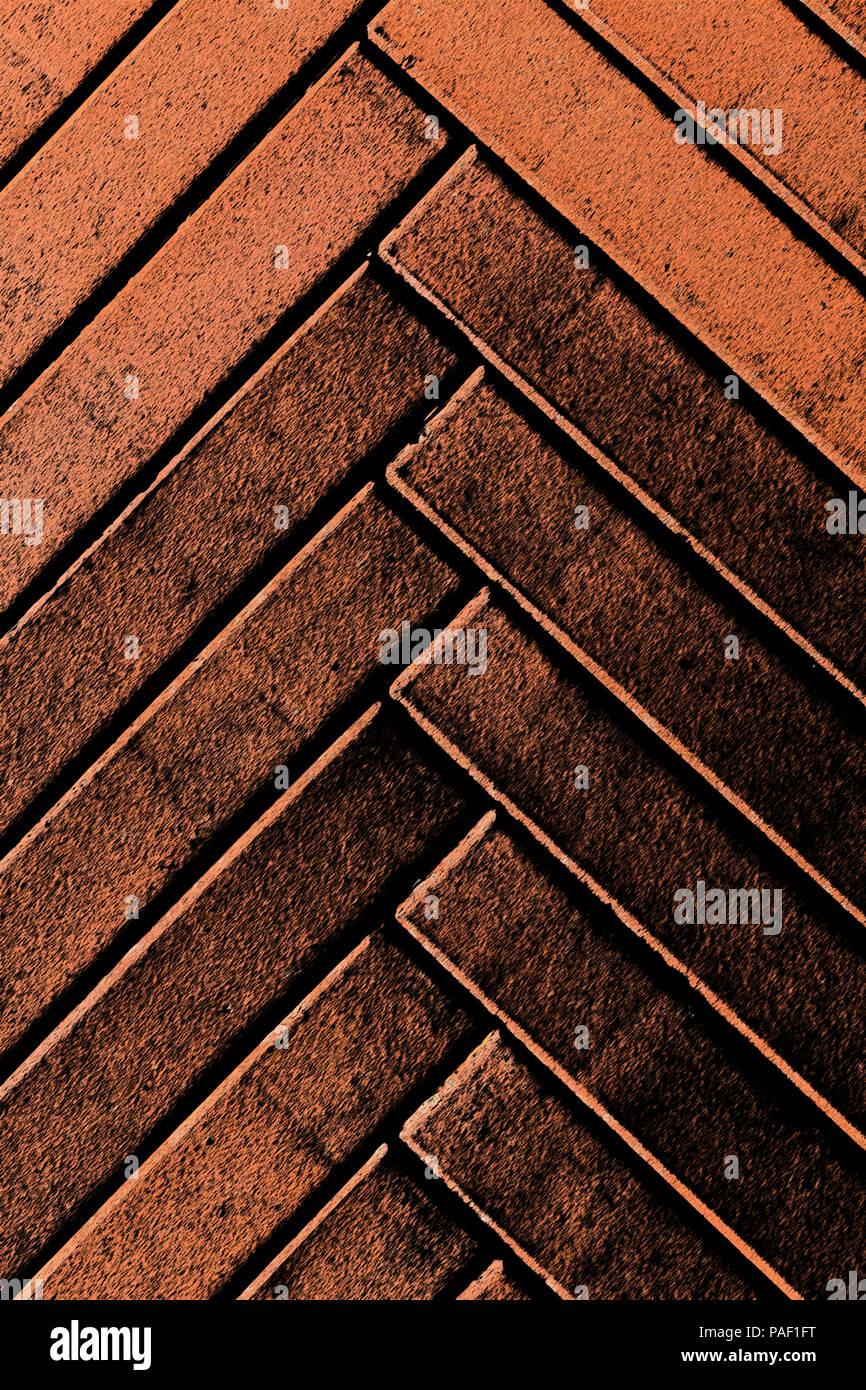 Red bricks herringbone pattern background stylised vertical composition - Stock Image