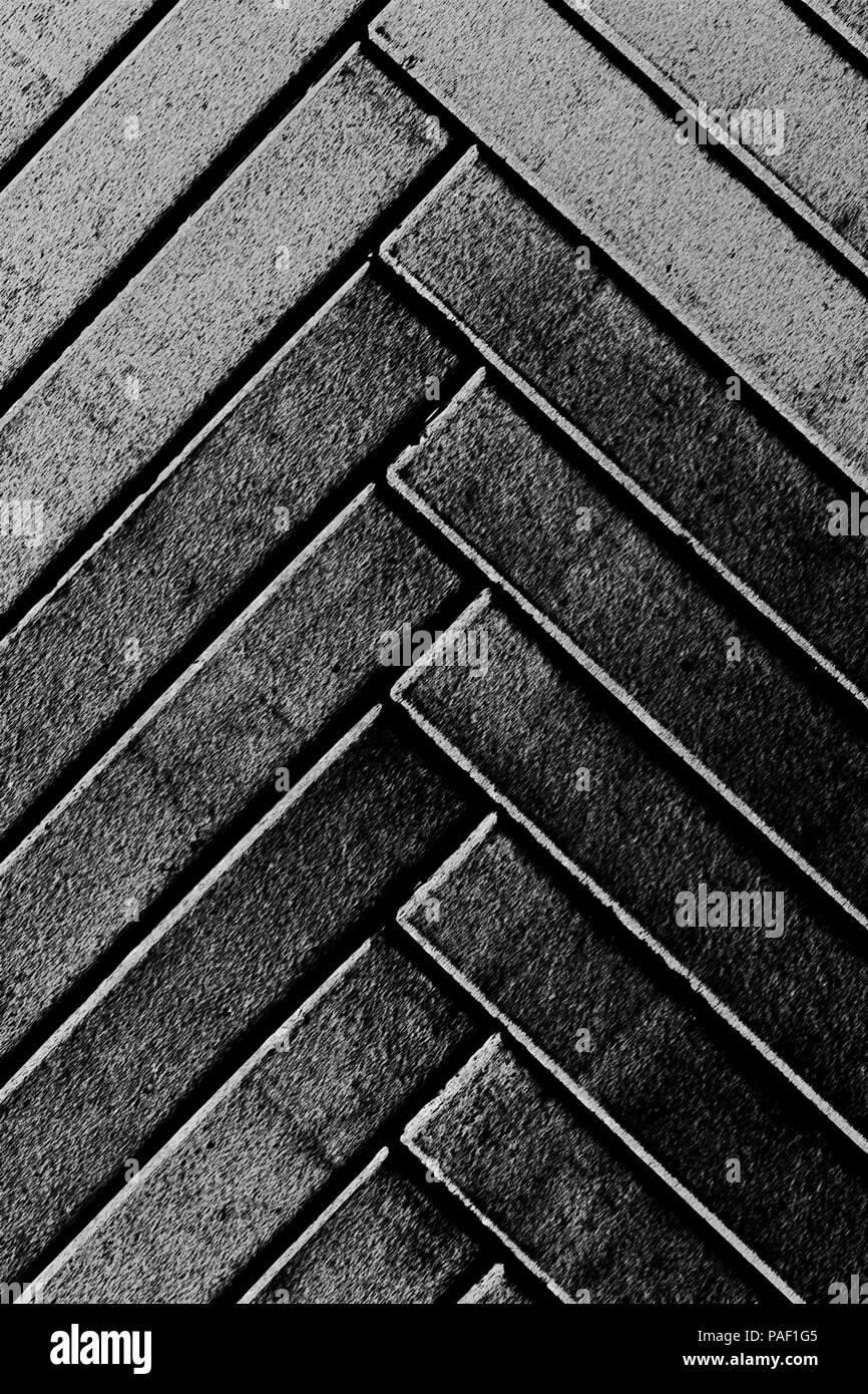 Grey narrow herringbone pattern stylised bricks background vertical composition - Stock Image