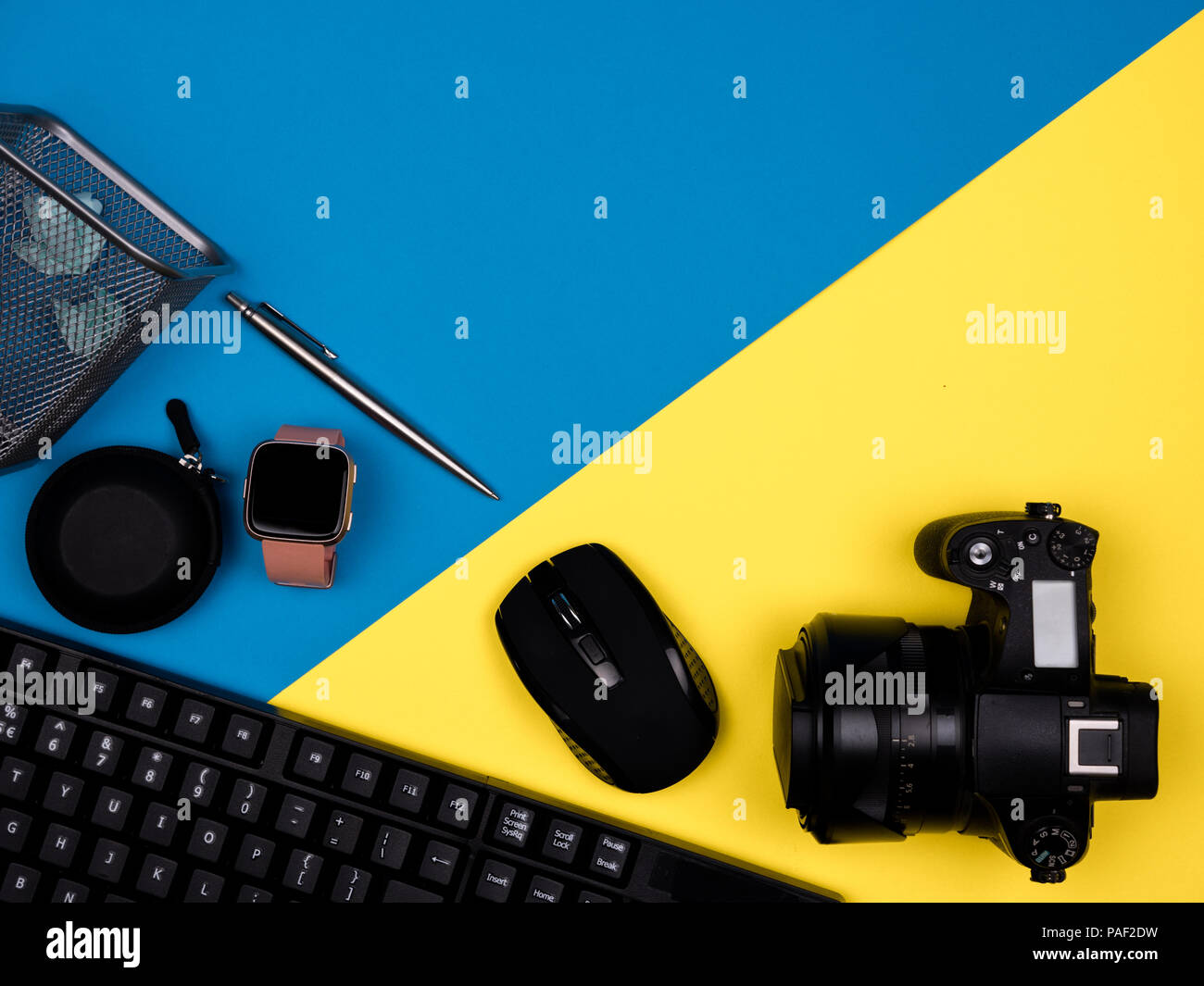 Keyboard, camera, mouse, watch, pen, jammed paper - Stock Image