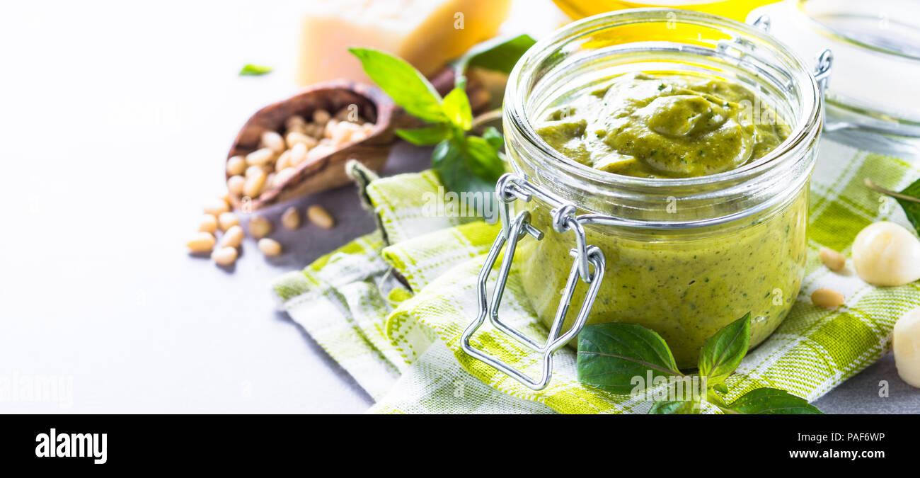 Pesto sauce in glass jar.  - Stock Image