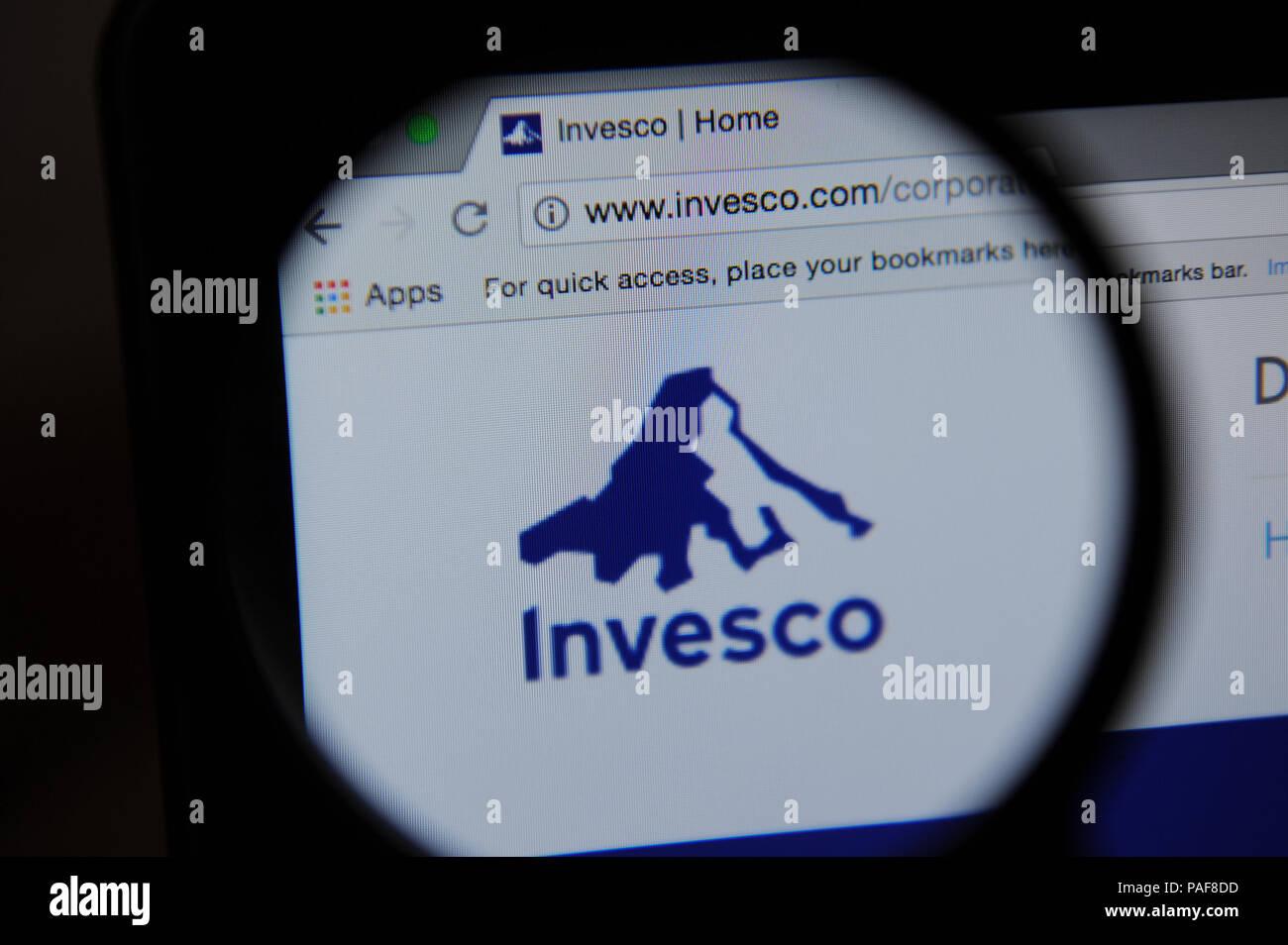 The Invesco Website Seen Through A Magnifying Glass Stock Photo