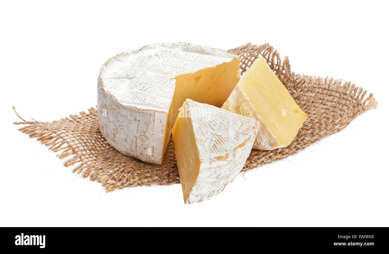 Camembert cheese isolated on white background with clipping path - Stock Image