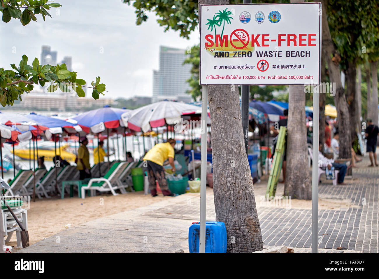 Smoke free and waste free beach warning sign with penalty for violation identified. Pattaya City, Beach Road, Thailand, Southeast Asia - Stock Image
