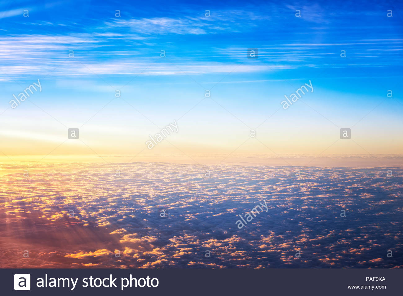 Early morning light bright sky above cloud on the plane view - Stock Image