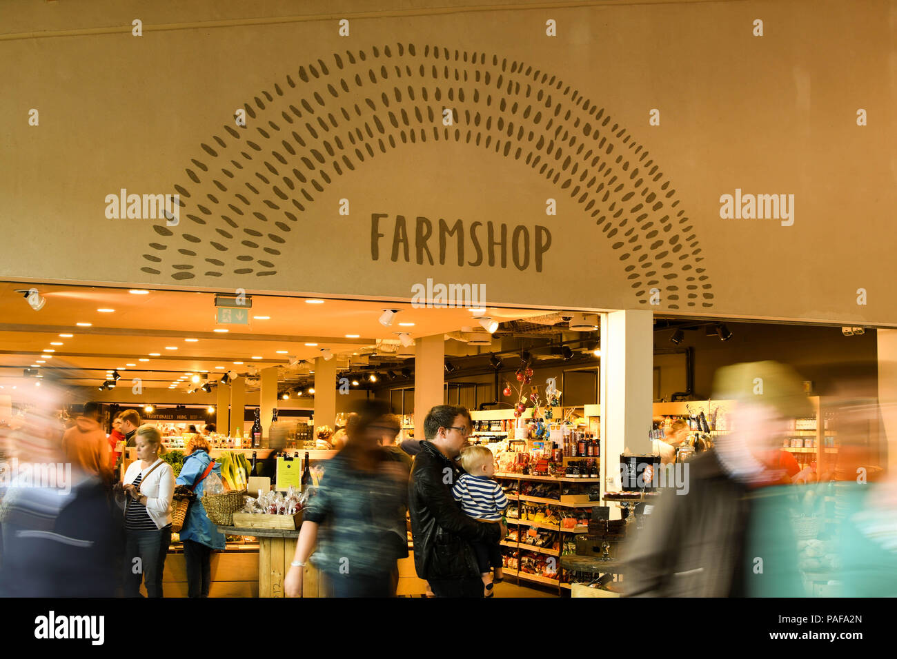 Interior view of entrance to the farm shop in the M5 motorway services in Gloucester. Slow shutter speed to blur the motion of visitors. Stock Photo