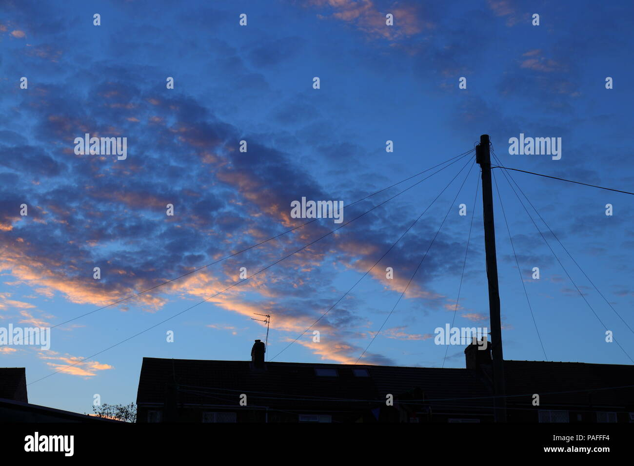 A summer sky at dusk above terraced houses in Leeds - Stock Image