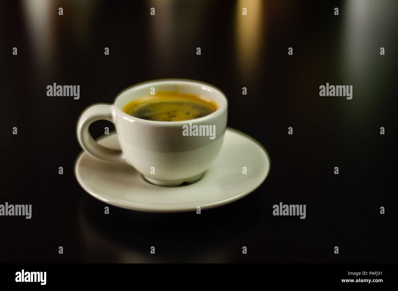 black coffee in a ceramic cup on the bar, energy drink in a public place, cafe - Stock Image