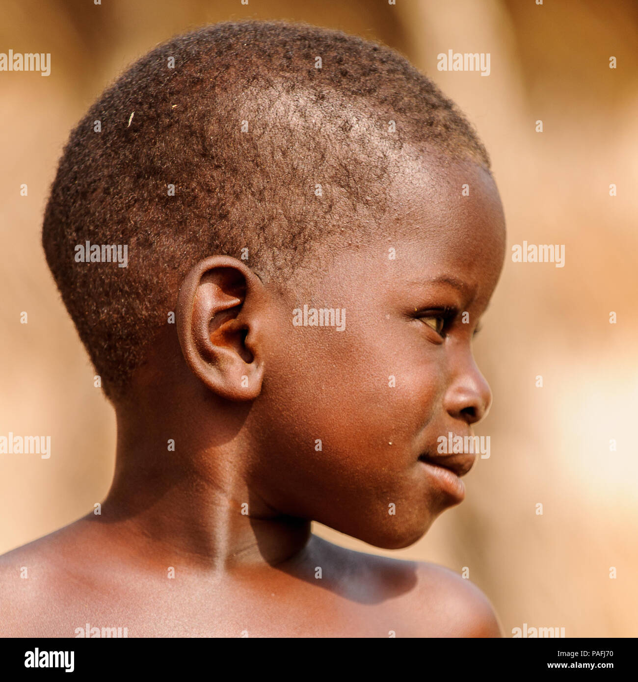 ACCRA, GHANA - MARCH 6, 2012: Unidentified Ghanaian boy smiles in the street in Ghana. Children of Ghana suffer of poverty due to the unstable economi - Stock Image