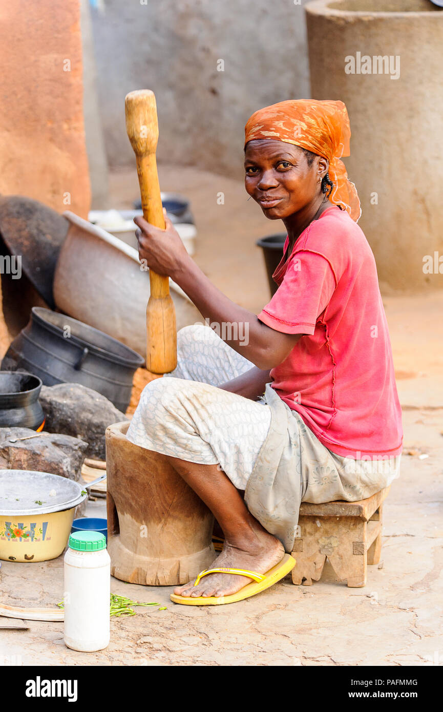 ANEHO, TOGO - MARCH 6, 2012: Unidentified Togolese woman sells stuff in the sreet in Togo, Mar 6, 2012. People in Togo suffer of poverty due to unstab - Stock Image