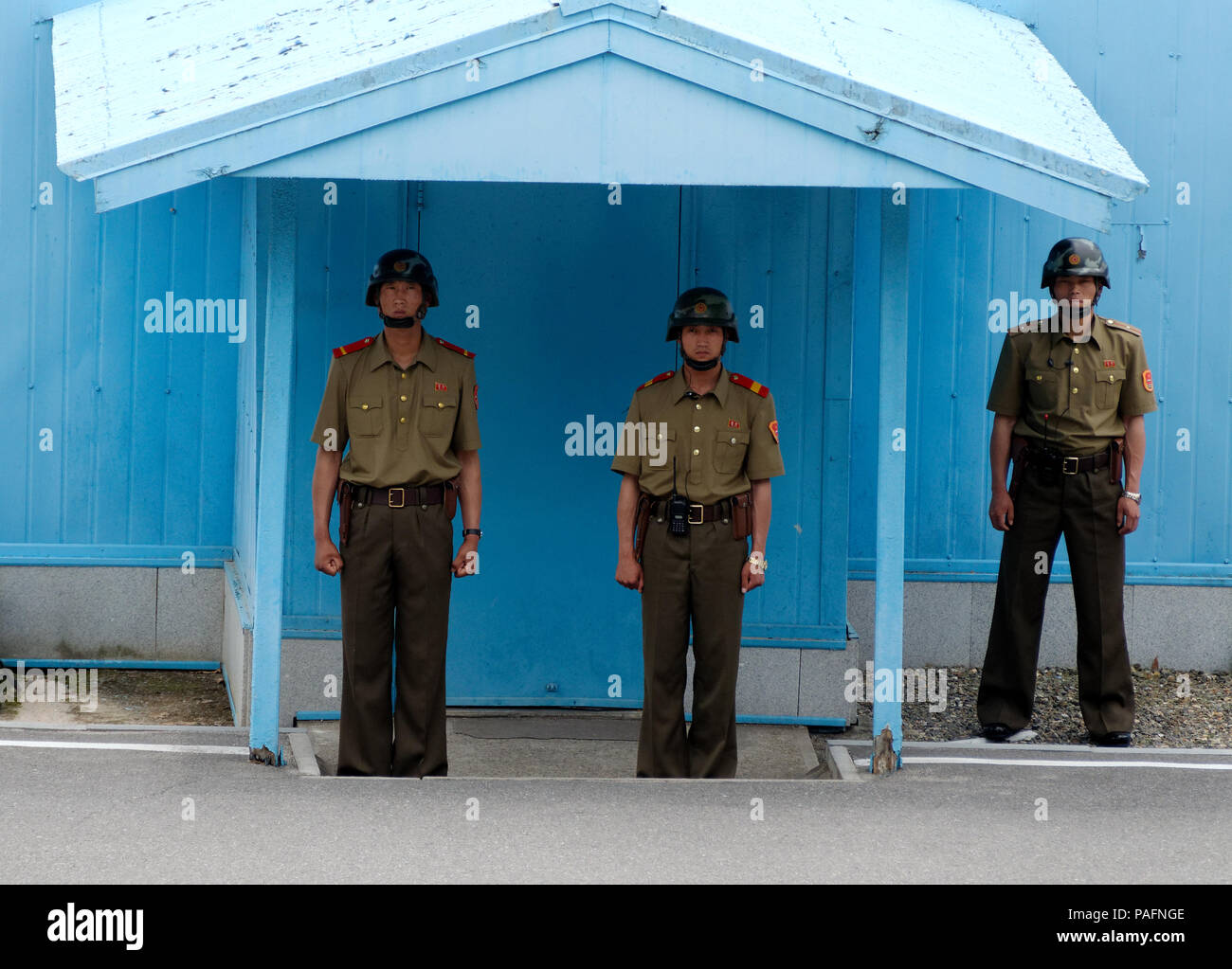 View from North Korea side in the Joint Security Area Truth Village Pamunjom of soldiers and the border within the DMZ. - Stock Image