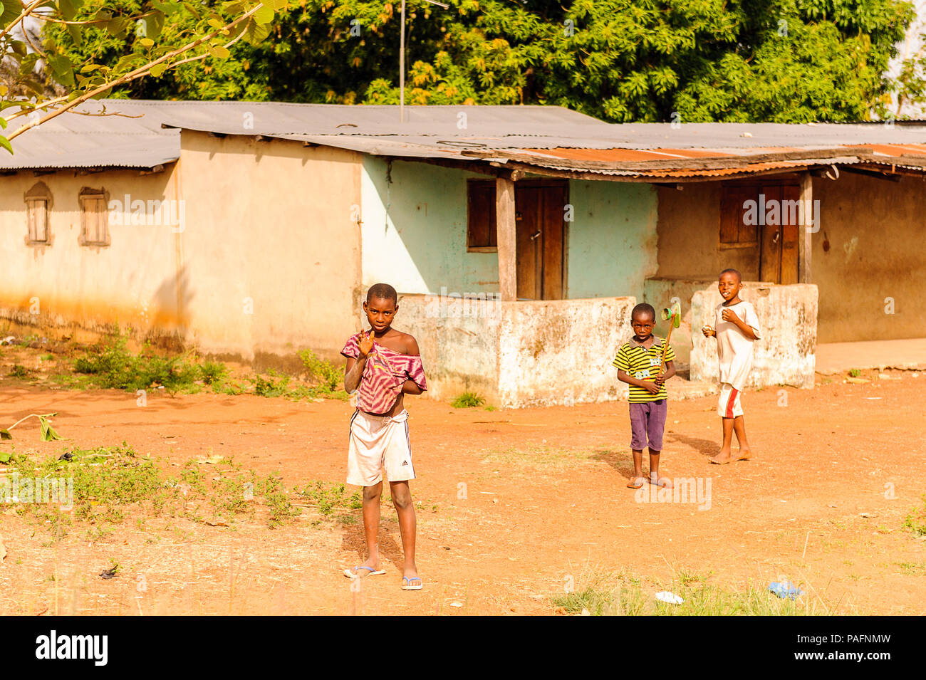 KARA, TOGO - MARCH 7, 2012: Unidentified Togolese children play in the yard  in Togo, Mar 7, 2012. People in Togo suffer of poverty due to unstable ec - Stock Image