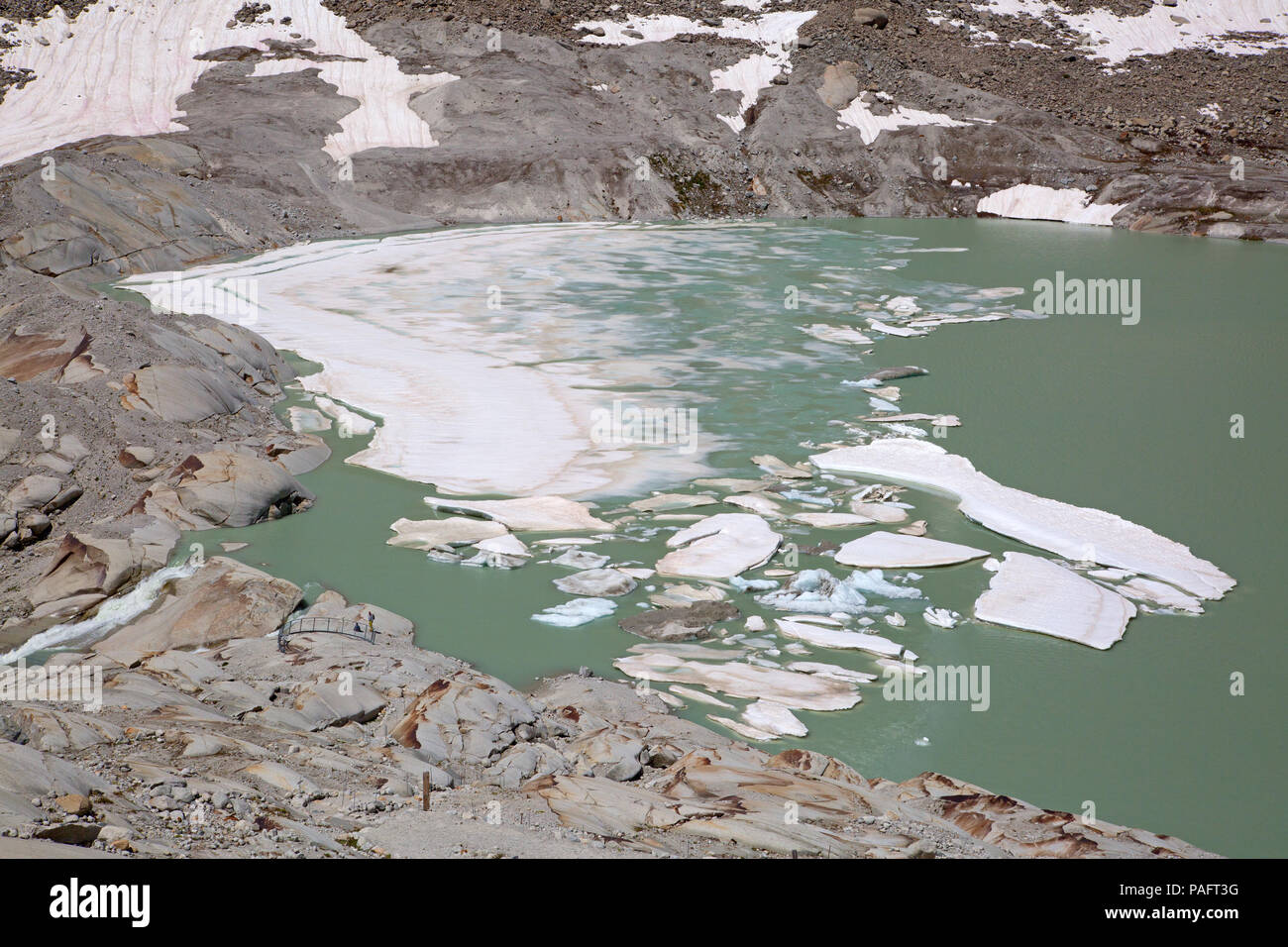 Rhone glacier, source of Rhone river, melting and retreating due to global warming. Rhone glacier is loosing up to 2 meters in length every year. Stock Photo