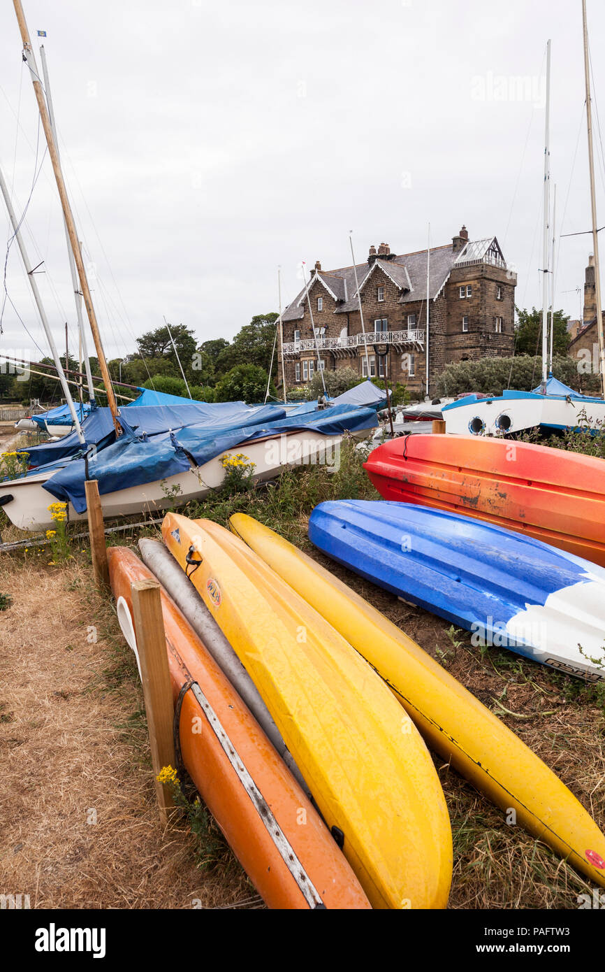 Boats moored in Alnmouth harbour,Northumberland,England,UK at low tide. - Stock Image