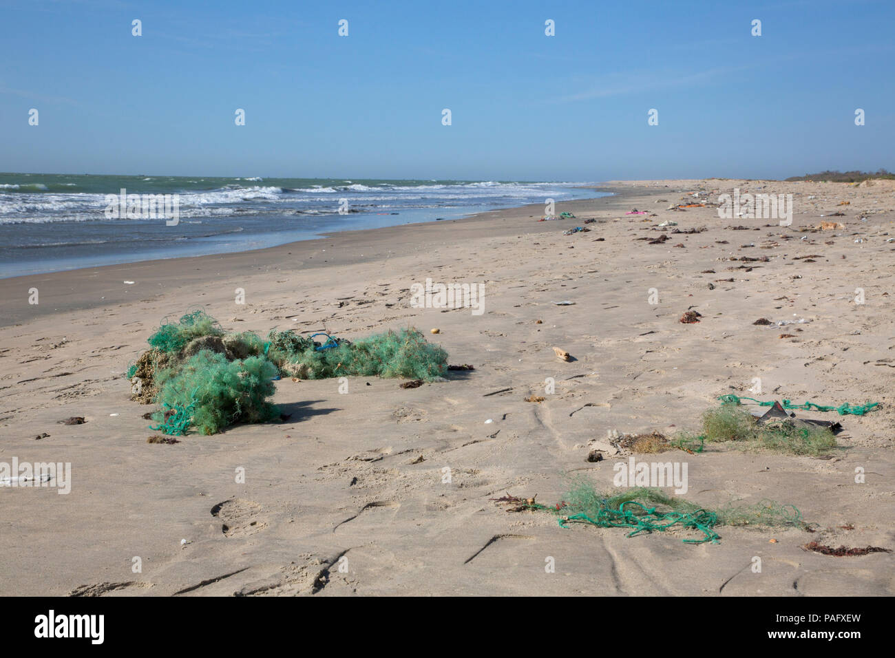 Discarded plastic fishing nets washed-up on beach, Tanji, The Gambia - Stock Image