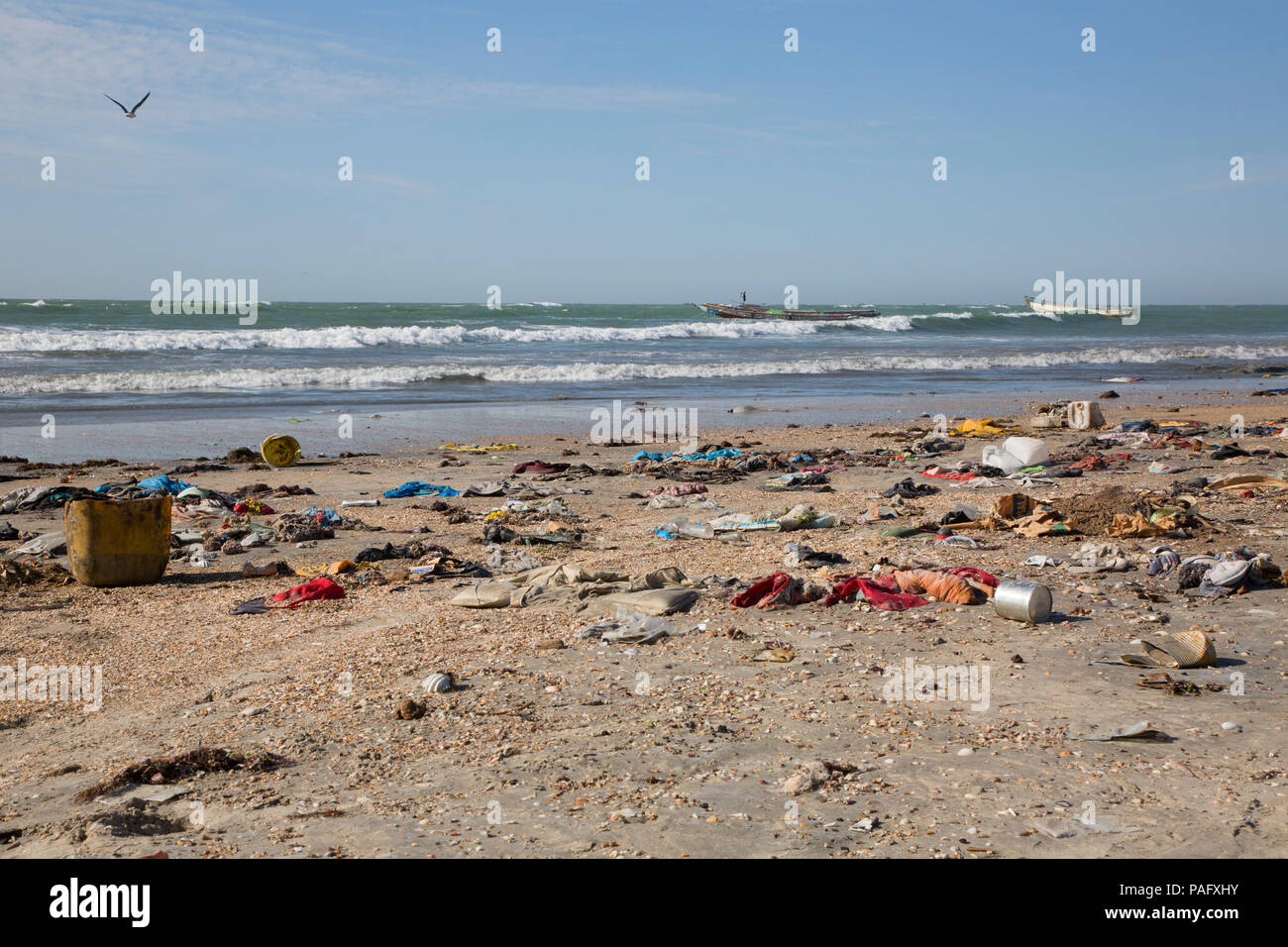Beach littered with plastic waste and other rubbish, Tanji, The Gambia - Stock Image