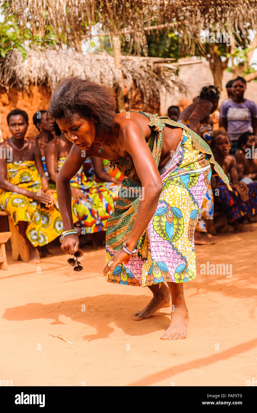KARA, TOGO - MAR 11, 2012:  Unidentified Togolese woman in a traditional dress dances the religious voodoo dance. Voodoo is the West African religion Stock Photo