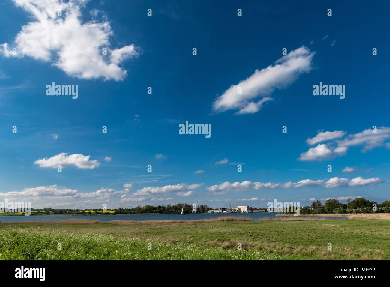 View across the Schlei Fjord, small town of Arnison opppsite bank,landscape Angeln,  Schleswig-Holstein, Germany - Stock Image