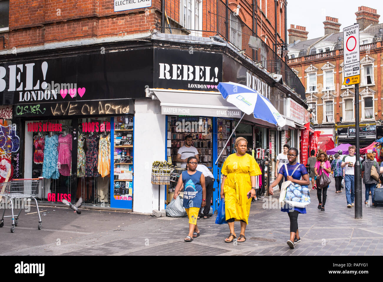 Street life in Electric Avenue, Brixton, London. - Stock Image