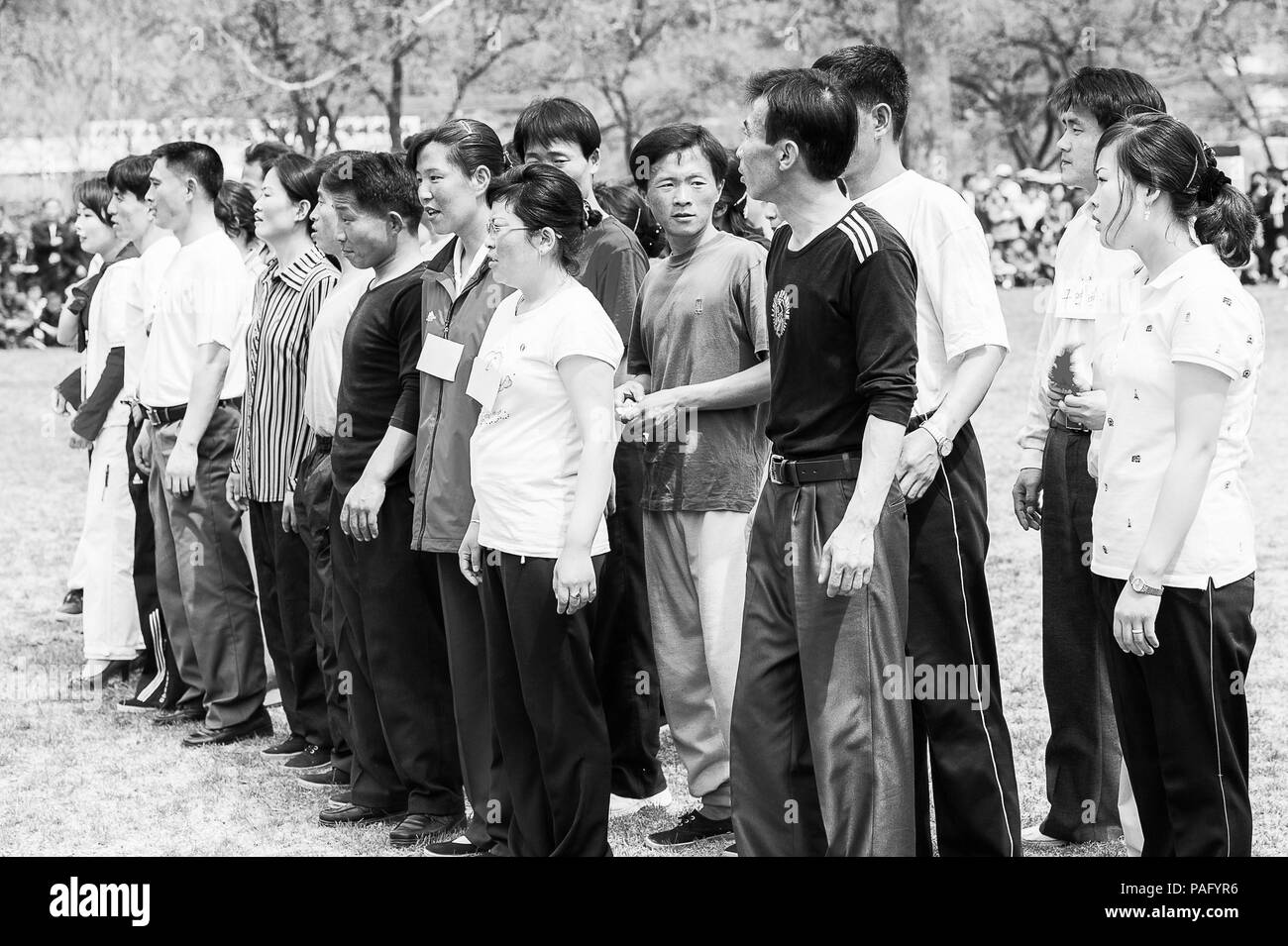 NORTH KOREA - MAY 1, 2012: Korean people are separating into 2 teams for tug of war game during the celebration of the International Worker's Day in N - Stock Image