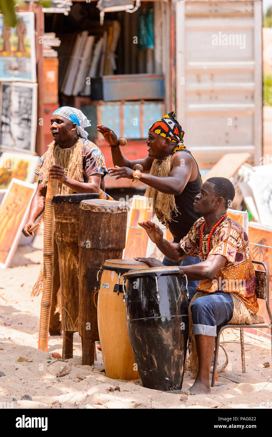 ANGOLA, LUANDA - MARCH 4, 2013: Local Angolan musicians make national sound with the drums in Angola, Mar 4, 2013. Music is one of the main African en - Stock Image