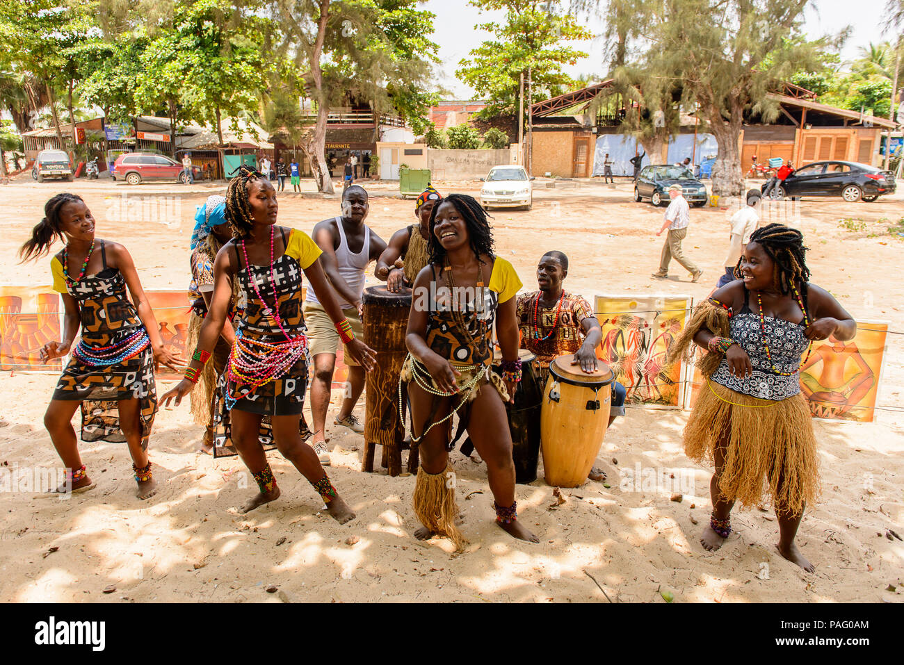 ANGOLA, LUANDA - MARCH 4, 2013:  Unidentified Angolan women make the street performance of the national falk dance for the tourists in Angola, Mar 4,  - Stock Image
