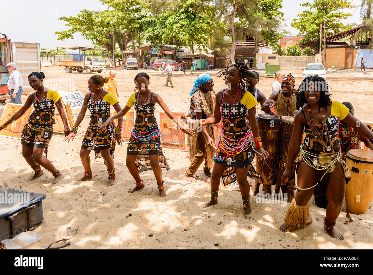 ANGOLA, LUANDA - MARCH 4, 2013:  Unidentified Angolan women make the street performance of the national falk dance for the tourists in Angola, Mar 4,  Stock Photo