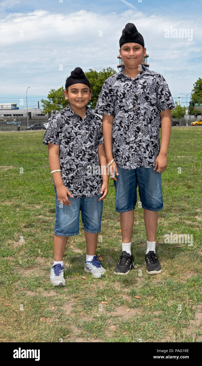 Posed portrait of brothers ages 6 and 12  attending the Sikh Gurmat Games at Smokey Park in South Richmond Hill, Queens, New York City - Stock Image