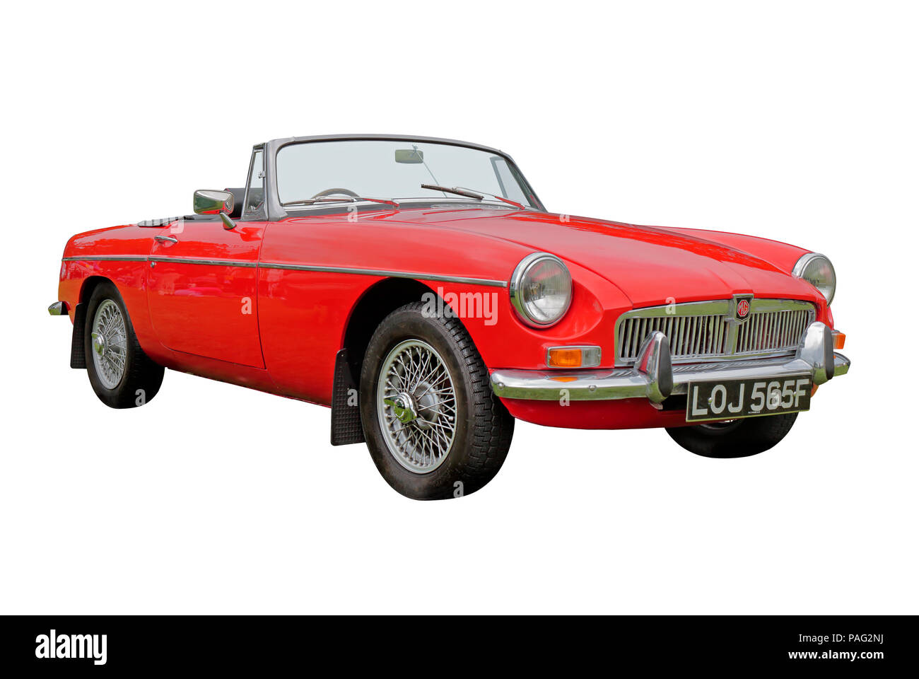 Red 1967 MGB Roadster isolated on a white background - Stock Image