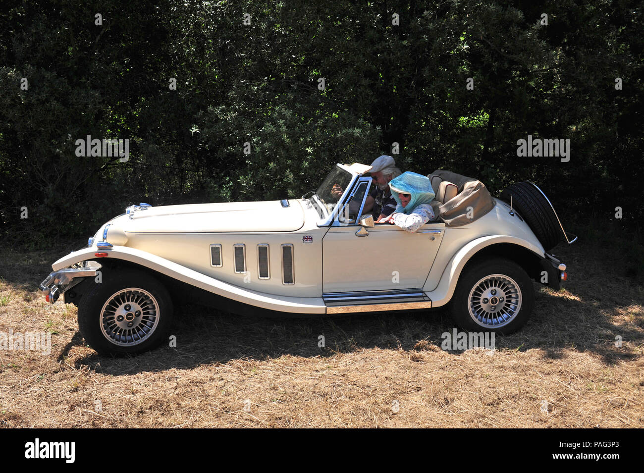 2 great friends in a wonderful two seater sports car, the 2.8 Ltr Panther Kallista seen here climbing the hills around the beautiful area of Languedoc Stock Photo