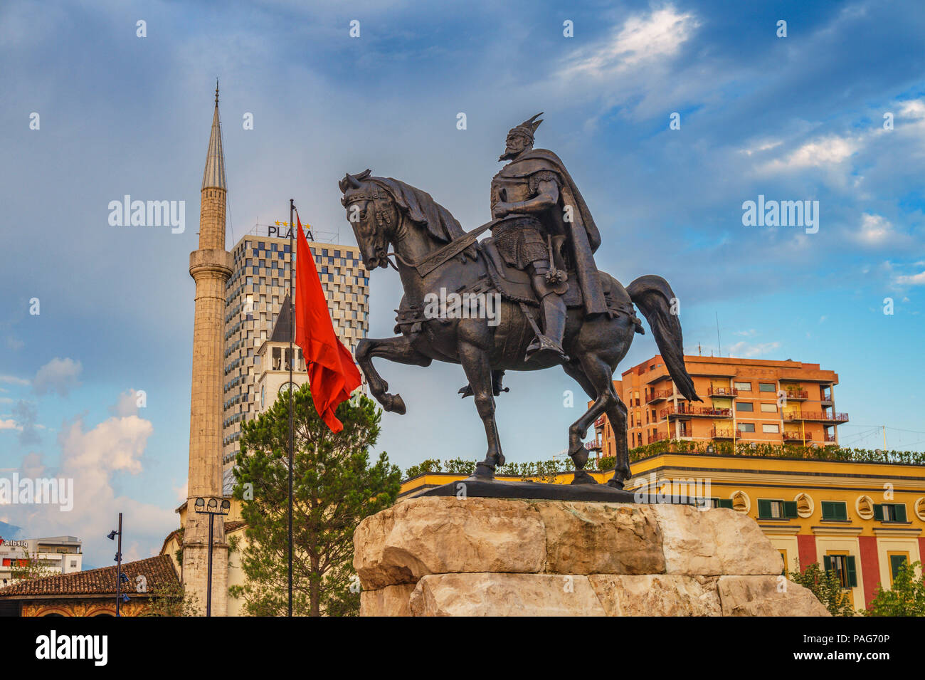Monument of Skanderbeg in Scanderbeg Square in the center of Tirana city, Albania against a cloudy sky. Tirana is the capital of Albania. - Stock Image