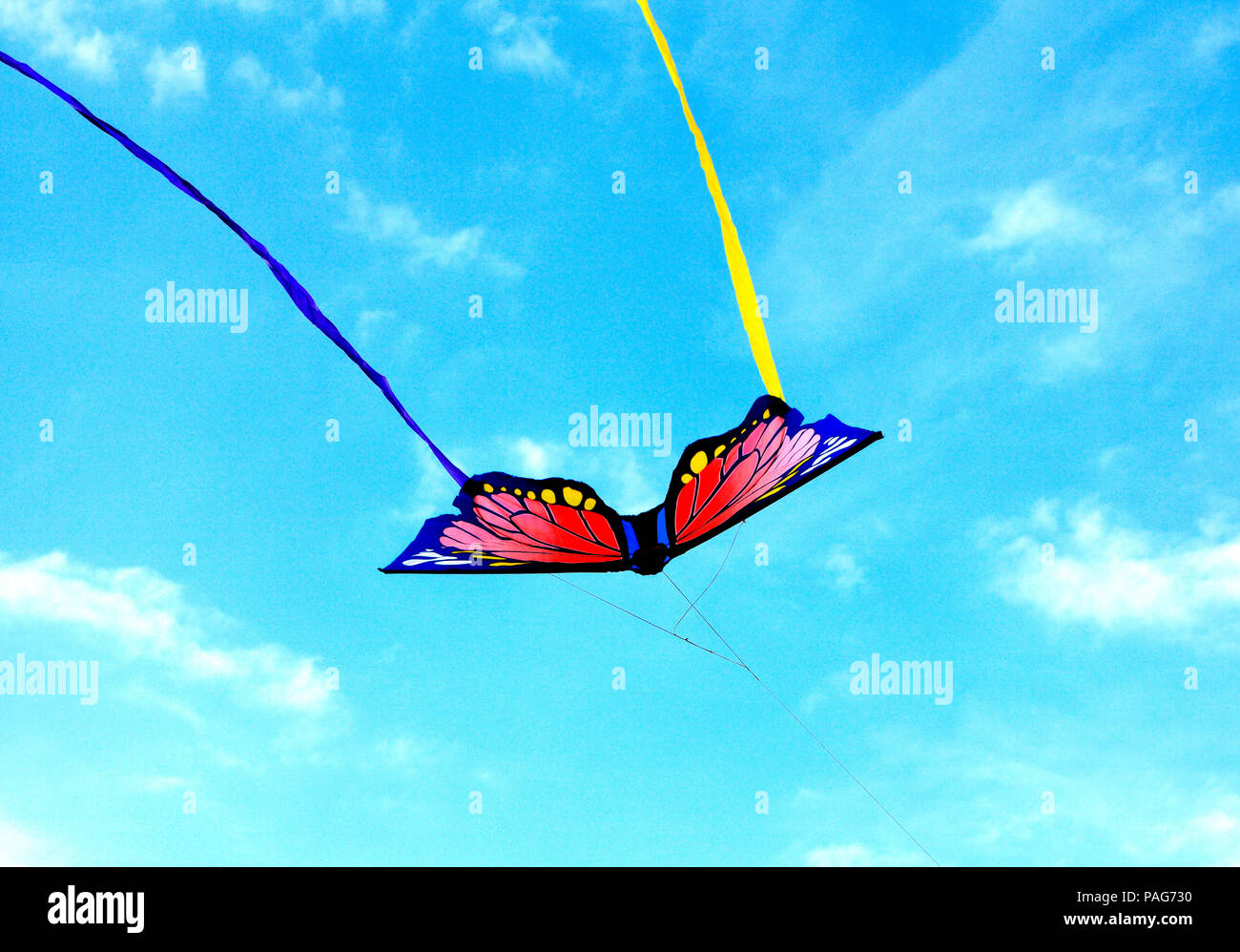Flying Butterfly Kite, colourful, multi colours, streamers, blue sky', colour, Hunstanton beach - Stock Image