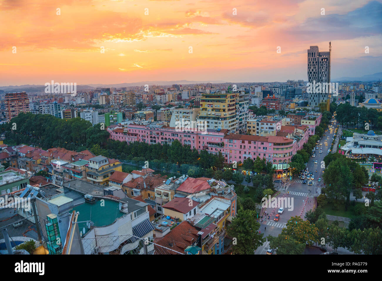Areal cityscape view of Tirana city center at sunset. Modern Architectural buildings and urban photography in Tirana, the capital of Albania. Stock Photo