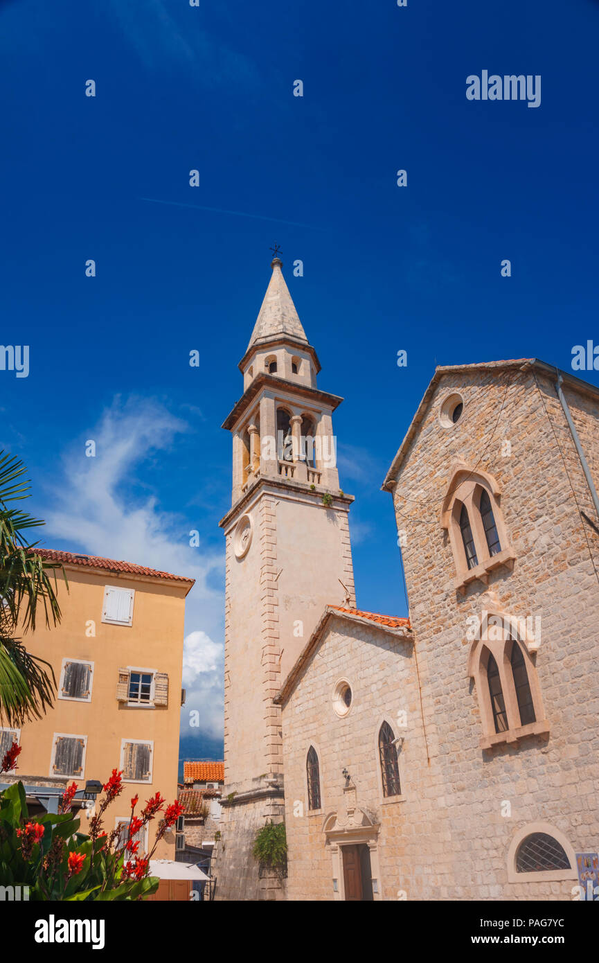 Saint John cathedral in Budva coastal town in Montenegro against a deep blue sky. Stock Photo