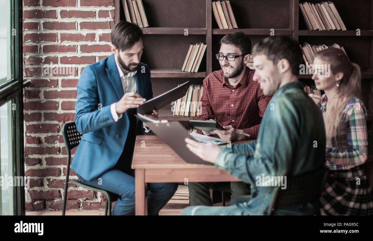 business team discussing a financial report on the company's pro - Stock Image