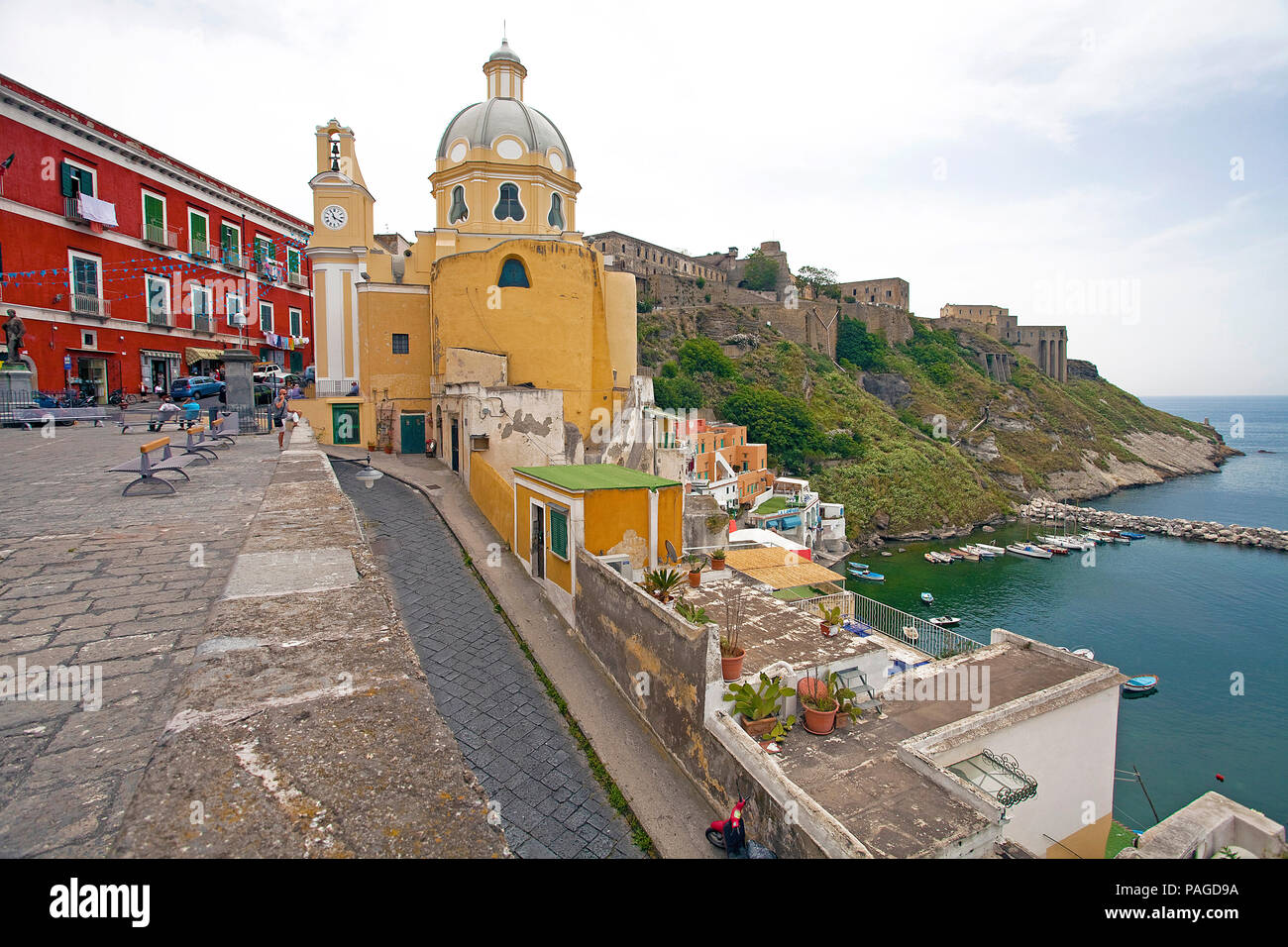 Church Chiesa della Madonna delle Grazie at Piazza dei Martiri and fortress Terra Murata, below Marina di Corricella, Procida, Gulf of Naples, Italy - Stock Image