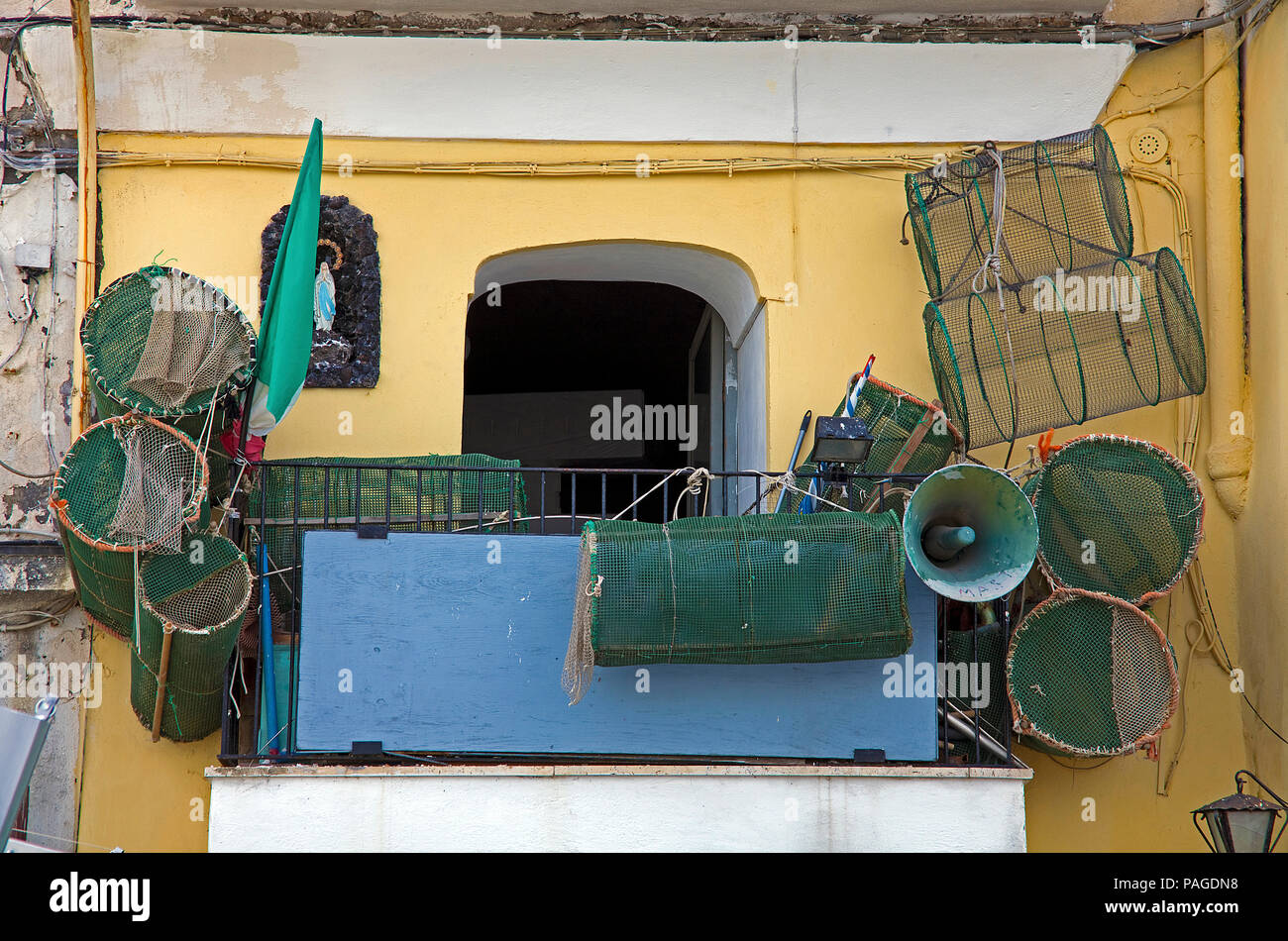 Typical fishing house, fish traps on balcony, fishing harbour Marina Grande, Procida island, Gulf of Naples, Italy - Stock Image