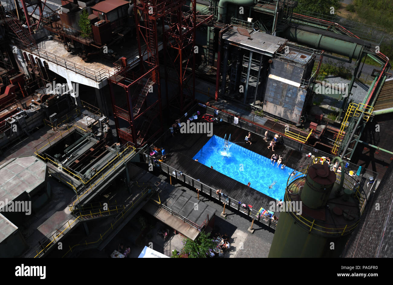Essen, Germany. 22nd July, 2018. The works swimming pool on the premises of the coking plant of the Zollverein Coal Mine Industrial Complex (Zeche Zollverein). The Frankfurt artists Dirk Paschke and Daniel Milohnic created the work swimming pool in 2001 in the course of the art project 'Zeitgenoessische Kunst und Kritik' (lit. contemporary art and criticism). Credit: Ina Fassbender/dpa - ATTENTION: editorial use only in connection with the latest coverage and only if the credit mentioned above is referenced in full/dpa/Alamy Live News - Stock Image
