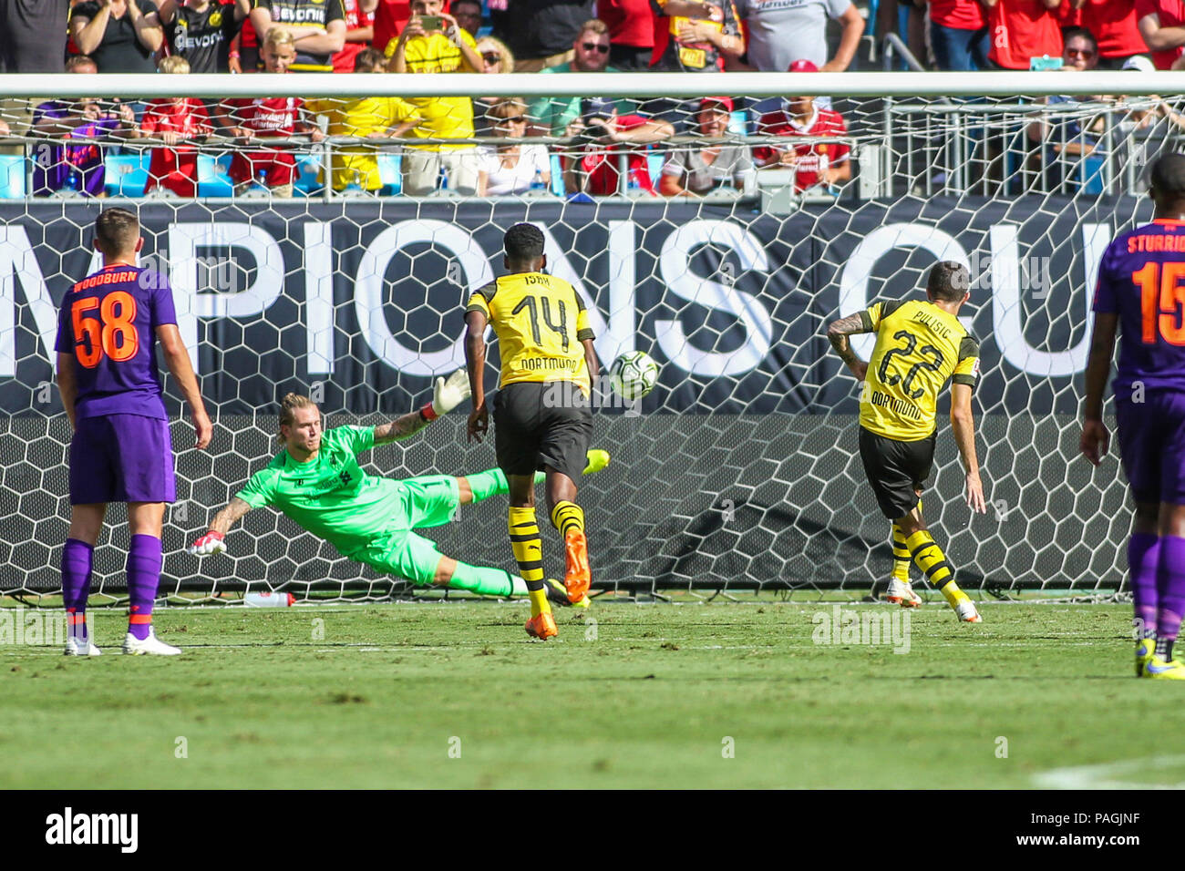 Charlotte, NC, USA. 22nd July, 2018. Borussia Dortmund midfielder Christian Pulisic (22) scores off a penalty kick in the second half during International Champions Cup action between the Liverpool FC vs Borussia Dortmund in Charlotte, NC. Jonathan Huff/CSM/Alamy Live News - Stock Image