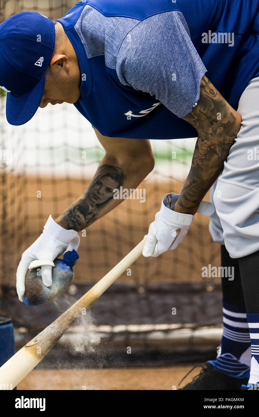 e7bcb0eadd44c A picture of Los Angeles Dodgers shortstop Manny Machado #8 getting his bat  ready before batting practice and a tattoo on his right forearm of his ...