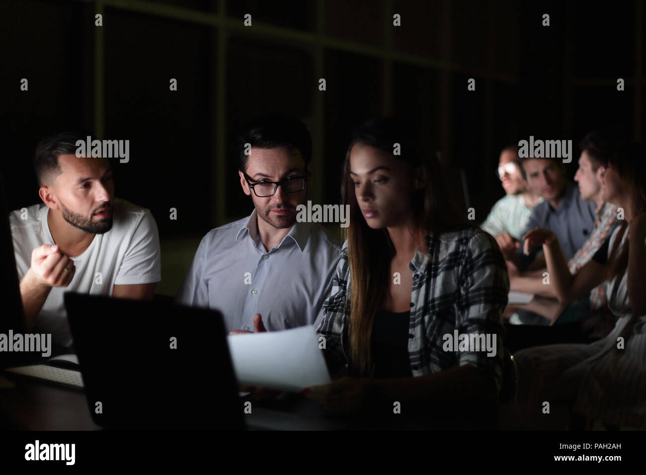 tired employees discussing business problems - Stock Image